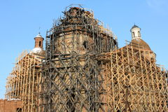 Restoration of an old beautiful church. With scaffolding Stock Photography