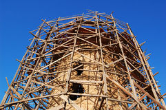 Restoration scaffold in ancient tower Stock Photo