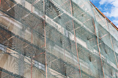 Restoration work of facade under green net Royalty Free Stock Photography