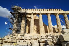 Restoration work in progress at beautiful world heritage classical Parthenon on marble block base on top of Acropolis with machine Stock Images