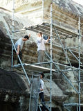 Restoration workers building scaffhold in Angkor Wat, in Siem Reap Stock Photo