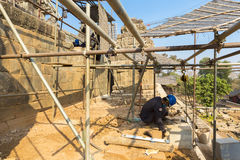 Restoration works at the Phnom bakheng Temple in Angkor. Royalty Free Stock Images