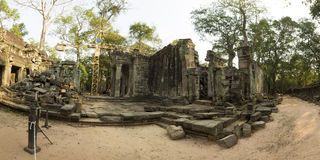 Restoration works at the Ta Prohm Temple in Angkor. Cambodia. Panoramic view of crane and restoration works at the ancient Prasat Ta Prohm Temple in Angkor Thom Stock Image