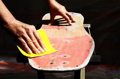 Restore an Old Skateboard. With a Yellow Sandpaper Stock Photos