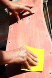 Restore an Old Skateboard. With a Yellow Sandpaper Stock Images