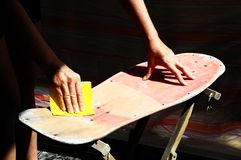 Restore an Old Skateboard. With a Yellow Sandpaper Royalty Free Stock Photos