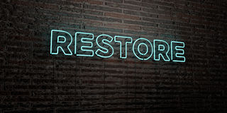 RESTORE -Realistic Neon Sign on Brick Wall background - 3D rendered royalty free stock image Stock Images