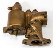 Antique automotive brass updraft carburetor. Restored antique automotive brass updraft carburetor Stock Photography