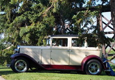 Restored Antique Cream And Burgundy Vehicle Royalty Free Stock Image
