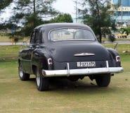 Restored Black Chevrolet At Playa Del Este Cuba Royalty Free Stock Photography