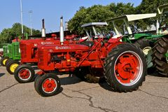 Restored C and M Farmall tractors. YANKTON, SOUTH DAKOTA, August 19, 2017: Restored vintage Farmall C and M tractors are displayed at the annual Riverboat Days Stock Photo