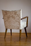 Restored chair. Restored wooden retro soft armchair Royalty Free Stock Photo