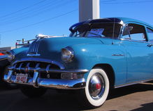 Restored Classic Blue Pontiac. With white-wall tires Royalty Free Stock Photo