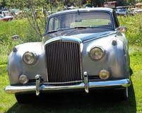 Restored Classic Silver Rolls Royce. Restored classic Rolls Royce sedan parked on grass Royalty Free Stock Photo