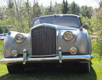 Restored Classic Silver Rolls Royce. Restored classic Rolls Royce sedan parked on grass Stock Images
