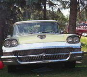 Restored Classic Two Toned Ford Sedan. Restored classic white and yellow Ford sedan parked on grass Stock Photos