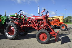 Restored Farmall Cub Tractor. YANKTON, SOUTH DAKOTA, August 19, 2106: Restored Farmall Cub  with a front end blade for pushing snow or soil is displayed at the Stock Image