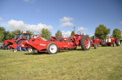 Restored Farmall machinery at a threshing show Stock Photo