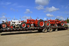Restored Farmalls arrive at a tractor show. DALTON, MN, September 14, 2015: Restored Farmall tractors arrive at the Dalton Threshing Reunion where 1000s attend Royalty Free Stock Images