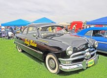 Restored 1950 Ford Custom Sedan. This is a nicely restored early 1950`s Ford sedan, a popular family car in its time. Note the split windshield and sun visor royalty free stock photo
