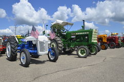 Restored Ford and Oliver tractors. YANKTON, SOUTH DAKOTA, August 19, 2106: A Restored blue Ford and Oliver tractor are displayed at the annual Riverboat Days Stock Images