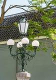 Restored historic lighting on a pillar Stock Images