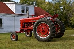 Restored 400 International Farmall tractor. MOORHEAD, MINNESOTA, September 20, 2017: A red restored Farmall International 400 is a model name and later a brand Stock Photography