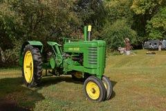 Restored John Deere tractor. MOORHEAD, MINNESOTA, September 20, 2017: The restored old John Deere tractor with non-stock fenders is a product of John Deere Co Stock Image