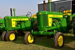 Restored 720 John Deere tractors. ROLLAG, MINNESOTA, Sept 1, 2017: Several restored John Deere 720 tractors are displayed at the annual WCSTR farm show in Rollag Royalty Free Stock Image