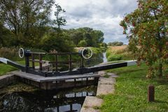 Restored lock gate on Pocklington Canal near Melbourne, East Yorkshire. Restoration on Gardham lock gate on Pocklington Canal carried out by Pocklington Canal stock image