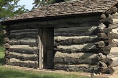 Restored Log Cabin. A restored 1870s log cabin in the city of Luray in Russell county Kansas. The home originally belonged to Jonathan Wesley Van Scoyoc stock photography