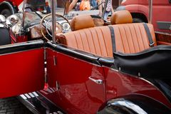 A restored old car. A fragment of the interior of a historic car stock photography