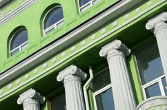 Restored old multi-storey building with antique columns, painted Royalty Free Stock Image
