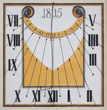 Restored old sundial with mural painting Royalty Free Stock Photos
