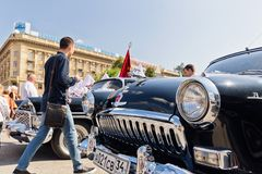 Restored and painted in shiny metallic black Volga GAZ-21 at the. VOLGOGRAD - SEPTEMBER 9: Restored and painted in shiny metallic black Volga GAZ-21 at the Stock Photography