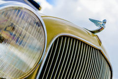 1933 restored plymouth. Front with emblem Royalty Free Stock Photo
