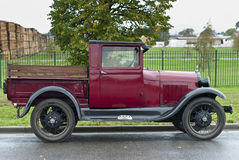 Restored red 1930's car by fence Stock Images