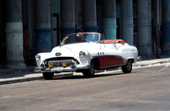 Restored Red And White Convertible In Havana Royalty Free Stock Image