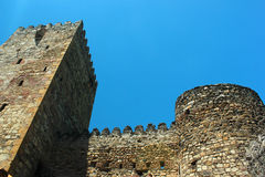 Restored renovated ancient ruins and walls of medieval Georgian fortress in Ananuri, Georgia.  Royalty Free Stock Photography