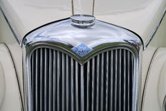Restored Riley front grill and badge. Restored Riley car showing chrome grill and badge stock images