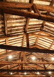 Restored roof with wooden beams and the lamps Stock Photos