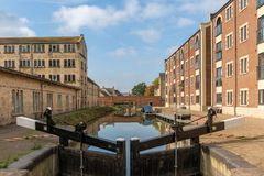 Lock gates on the restored Stroudwater canal and Oils Mills Bridge running through Ebley Mills, Stroud royalty free stock photos