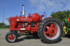 Restored Super M FARMALL. YANKTON, SOUTH DAKOTA, August 19, 2106: Restored Farmall 560 Diesel tractor is displayed at the annual Riverboat Days celebrated the Stock Photography