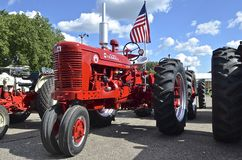 Restored Super M Farmall. YANKTON, SOUTH DAKOTA, August 19, 2106: A Restored Farmall Suoer M bearing the American flag is displayed at the annual Riverboat Days Royalty Free Stock Photo