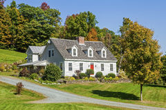 Restored Traditional Cape-style House With Red Front Door Stock Photos