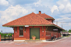 Restored Train Station in Tyler Texas. Restored Train Depot in the historic district of Tyler, Texas. Brick streets surround this renovated building. Blue cloudy royalty free stock photography