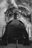 Restored Victorian era steam train engine with full steam in bla Royalty Free Stock Photos