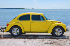 Restored vintage 1974 Volkswagen Super Beetle. At the beach on a sunny afternoon royalty free stock photos