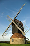 Restored windmill. A restored windmill tops a hill in the English countryside royalty free stock photography