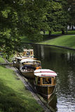 Restored wooden boats moored at Riga canal Royalty Free Stock Images